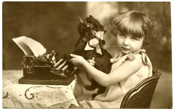 Cute French Girl With Typewriter