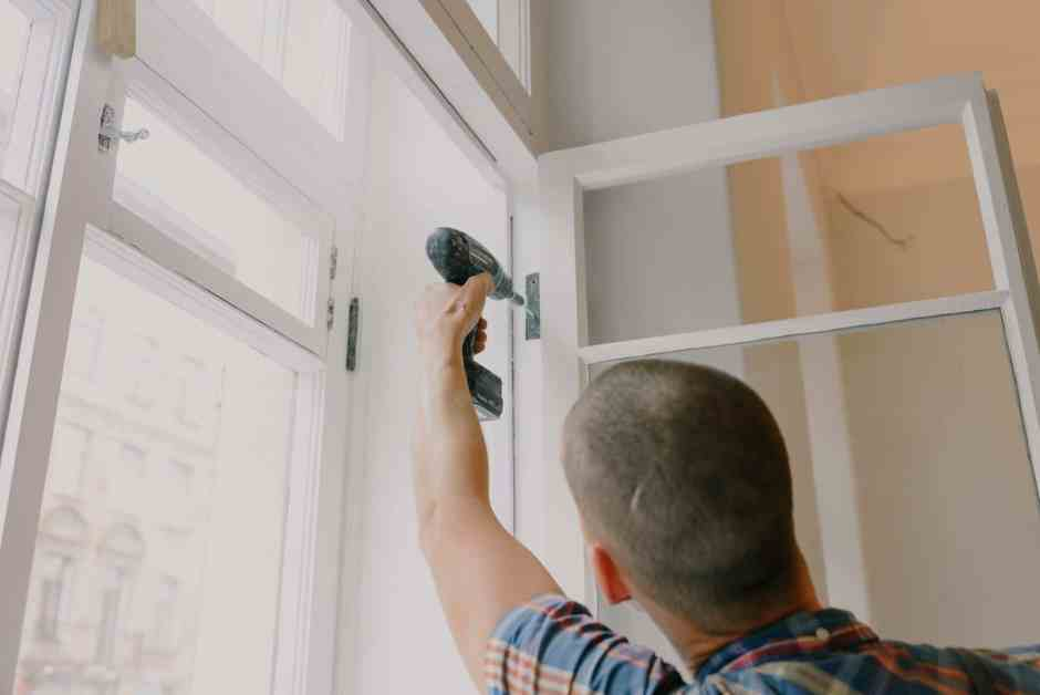 anonymous man installing window in room
