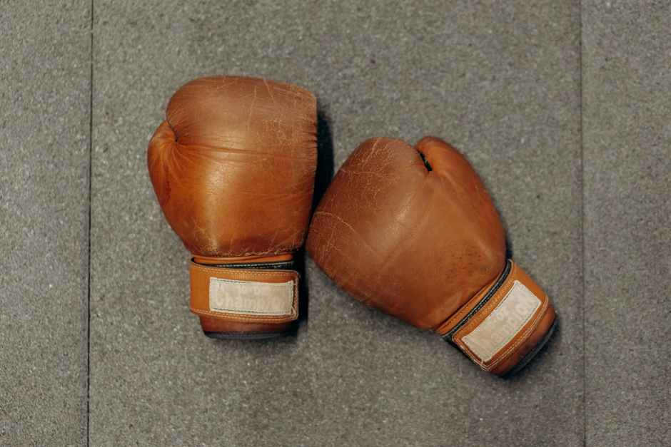 pair of boxing gloves on gray surface