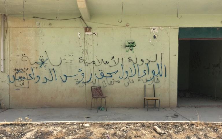 ISIS graffiti Yazidi village Sinjar Iraq