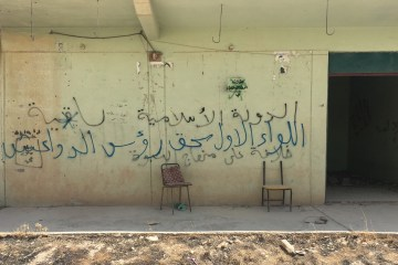 ISIS graffiti Yazidi village Sinjar Iraq