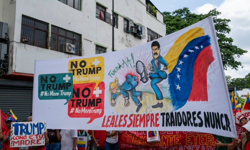 Venezuela no more Trump protest Maduro banner