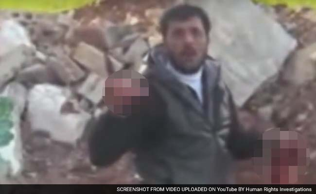 Syrian rebel eating heart Abu Sakkar