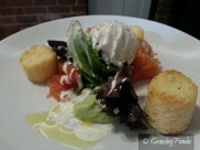 our salmon gravlax with polenta chips, avocado puree, poached egg & creme fraiche, dill & mustard dressing