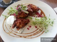 Cauliflower Fritters, Snow Pea Shoots, Pomegranate Molasses and Minted Yoghurt with a Poached Egg
