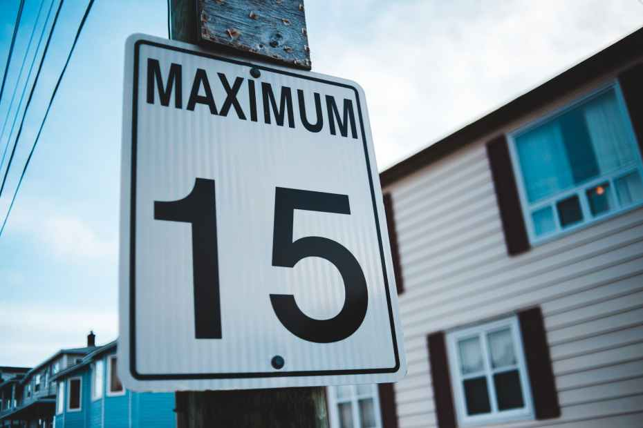 road sign with speed limit number in town