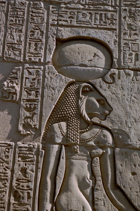 Goddess Sekmet shown with her sun disk and cobra crown from a relief at the Temple of Kom Ombo, cat goddess bast