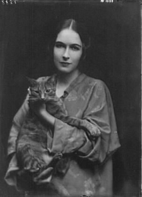 Miss Mona Pujo with Buzzer the Cat