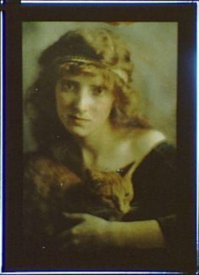 Woman Wearing a Headband holding Buzzer the Cat 1906