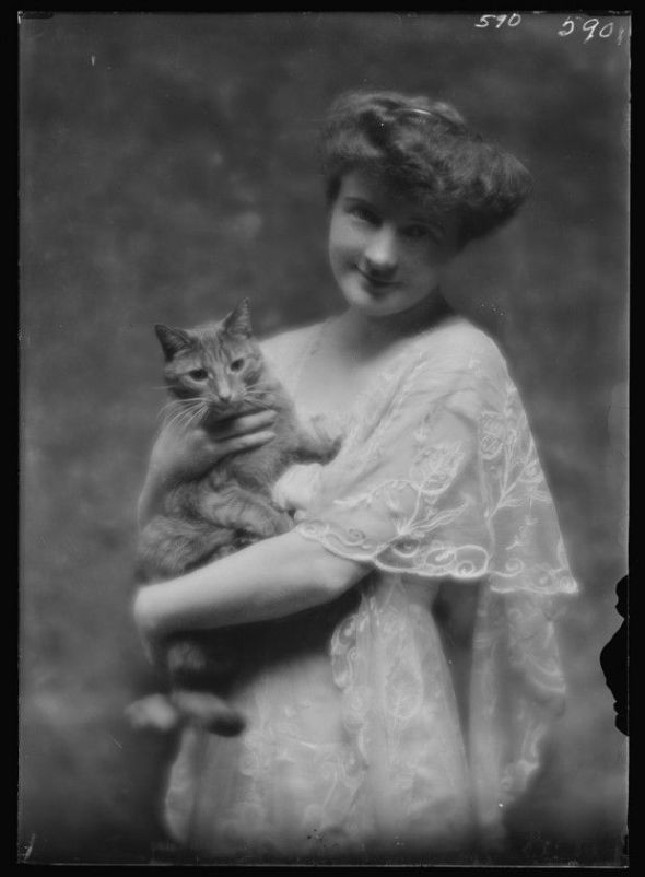 Unknown Woman with Buzzer the Cat 1910 cats in photography