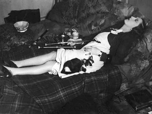 Woman with a Cat in an Opium Den 1931
