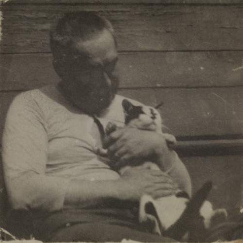 Thomas Eakins Holding a Cat, 1895