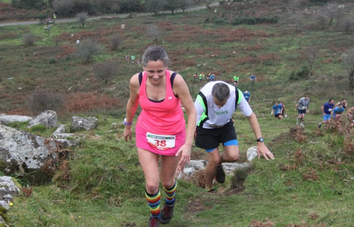 Female runner climbing during a race