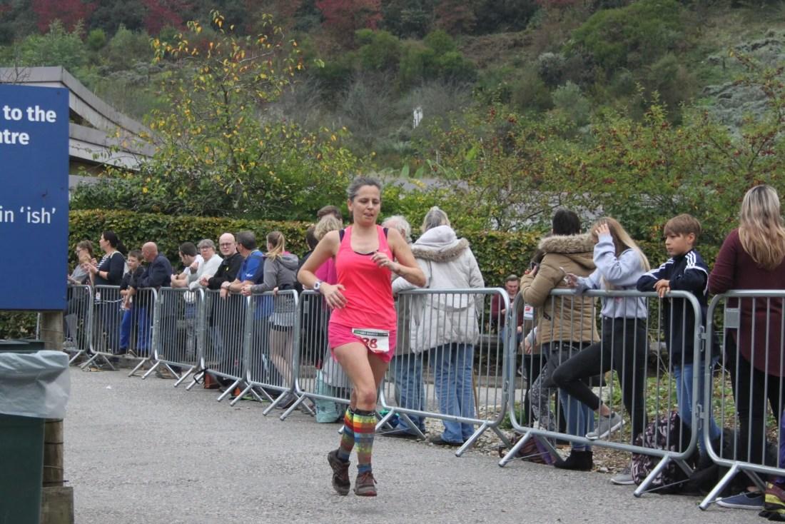 Woman coming to the finish line marathon