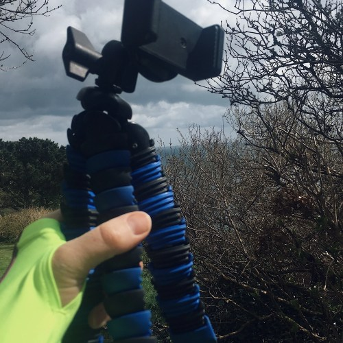 Hand holding Mini Tripod for iPhone