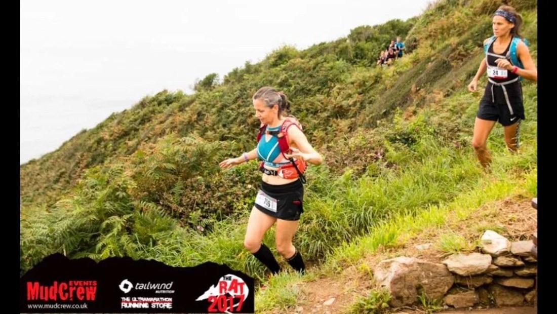 Lady running Downhill Trails