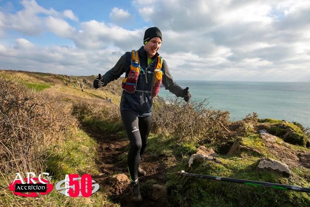 Man Running coast sea cliffs