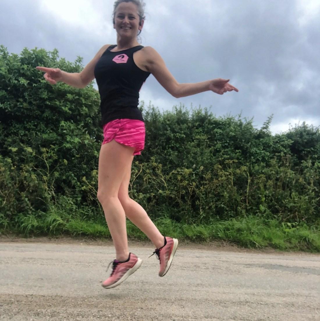 Woman running along a road