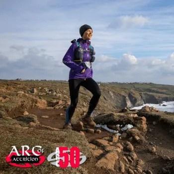Lady running coast path sea