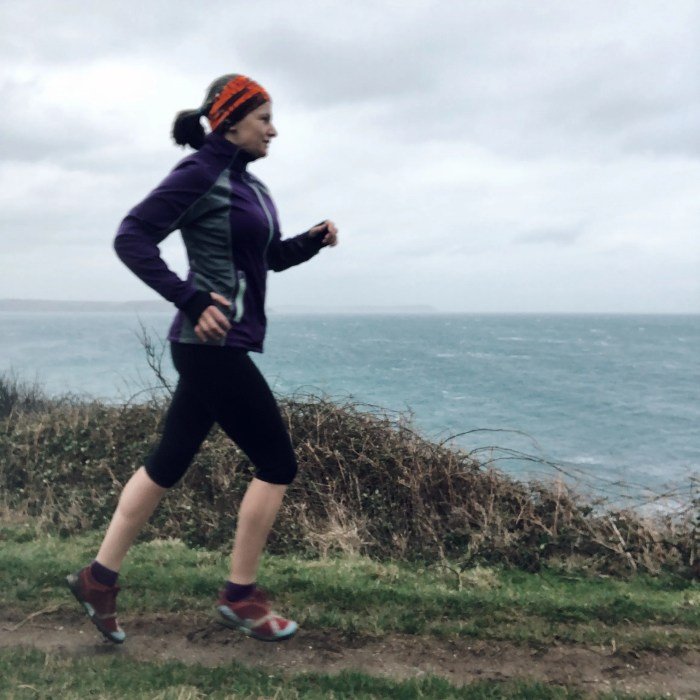 Woman running coastpath