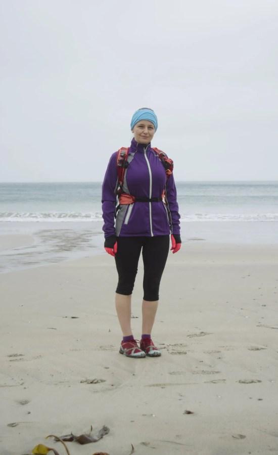 Lady standing on beach running