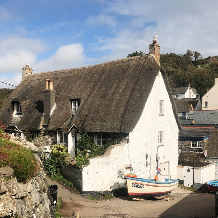 Thatched Cottage and Boat