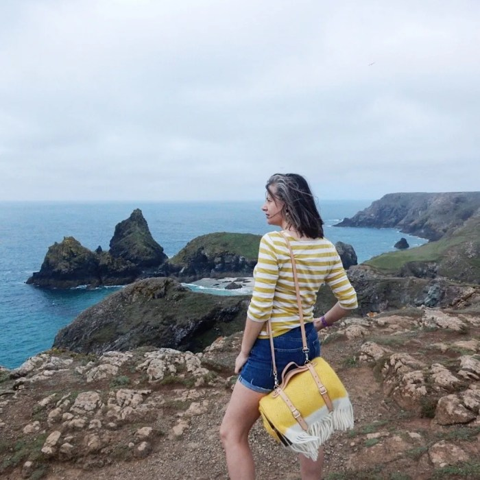 Woman standing at Kynance Cove with Atlantic Blanket