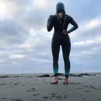 Woman pulling zip of wetsuit down