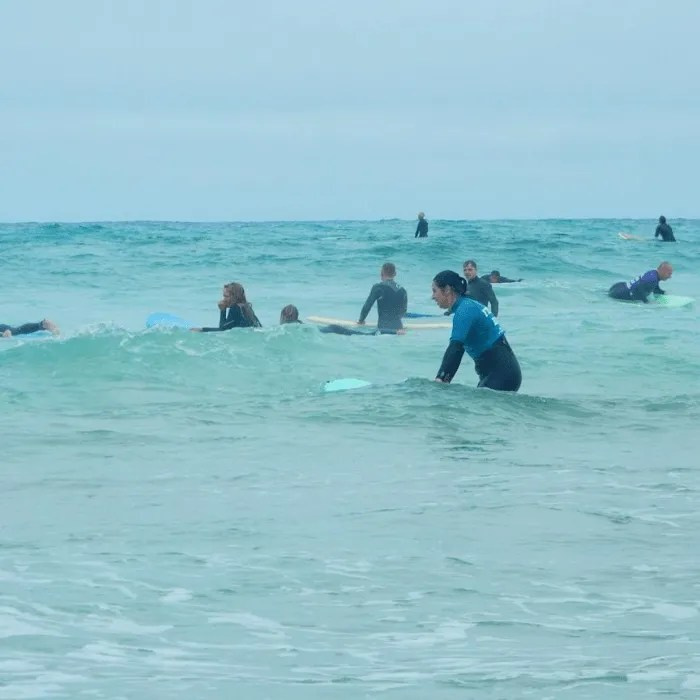People learning to surf on Fistral Beach