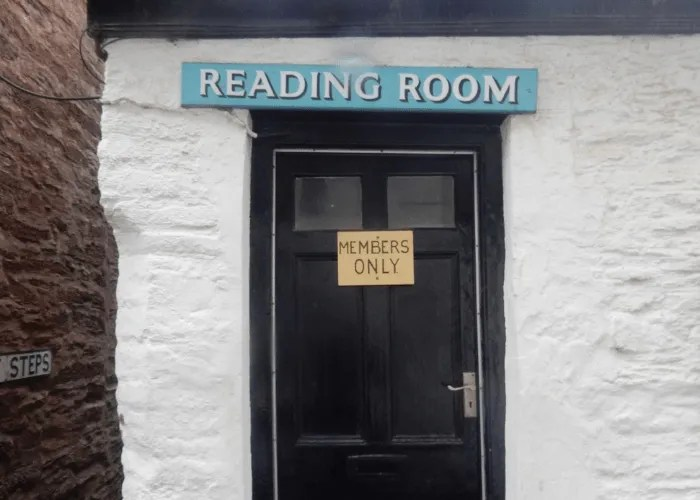 Blue Reading Room sign above a black door