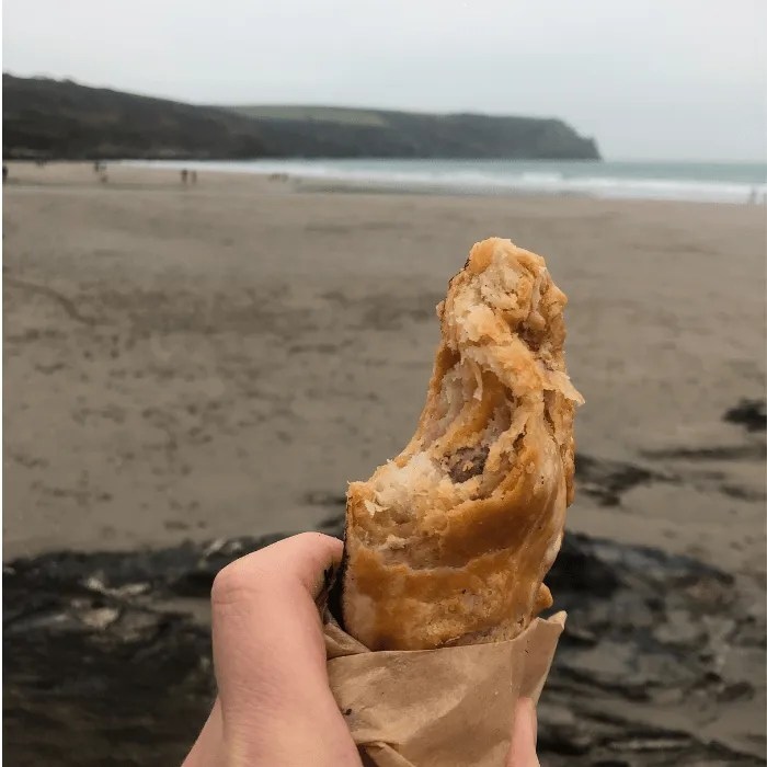 A Cornish Pasty being eating on the beach