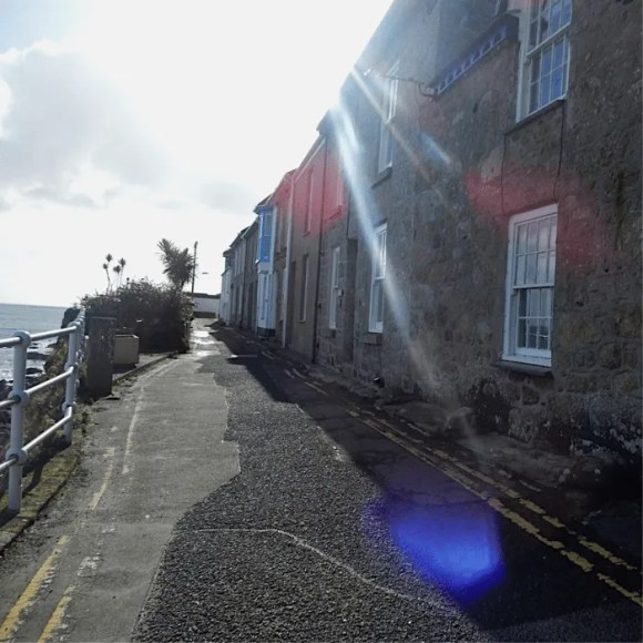 A row of terraced houses overlooking the sea in Mousehole
