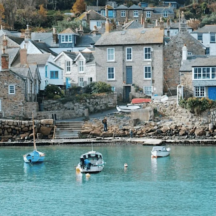 Houses on the waterfront at Mousehole at high tide