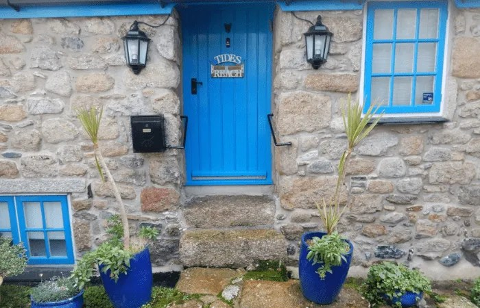A house with a blue door and window frames