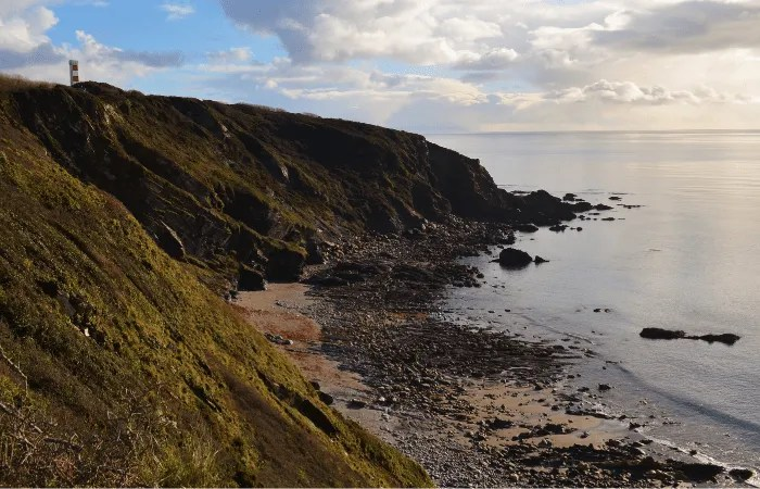Gribbin Head Daymark and hidden cove on the south west coast path
