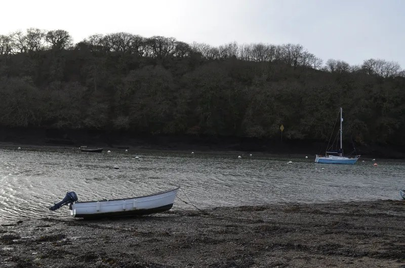 Percuil River at low tide with 2 boats