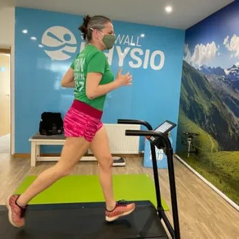 Woman running on a treadmill have a gait analysis at the Run Lab