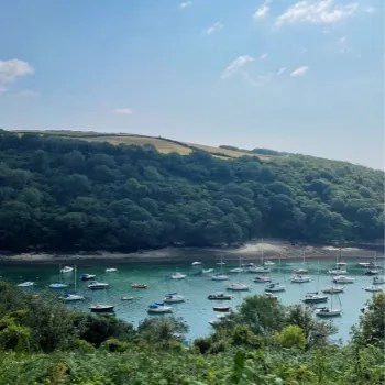 the estuary along Fowey Hall Walk with boats on the water and woodland