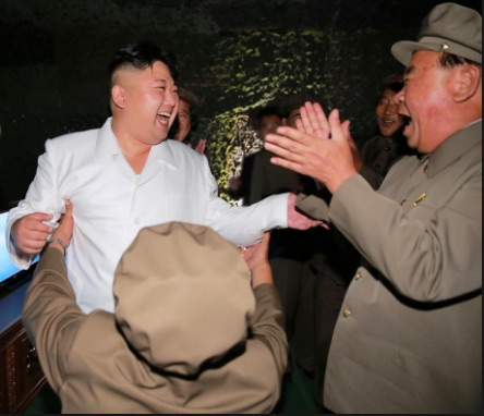 Kim Jong-un dances with soldiers as he celebrates a North Korean missile test. Everybody is happy.