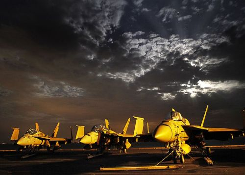 Wars and Rumors of Wars Title Photo - US Navy Jets against background of storm clouds