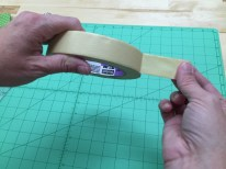 Peel a strip of several layers of tape off of the roll.