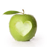 green apple with heart carved out