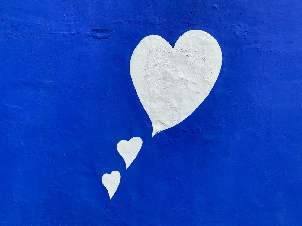 white love hears on blue wall