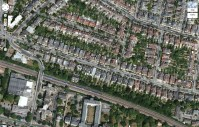 Putney, London, UK. There aren't any visible solar panels, and the flat-roofed buildings do not have green roofs.