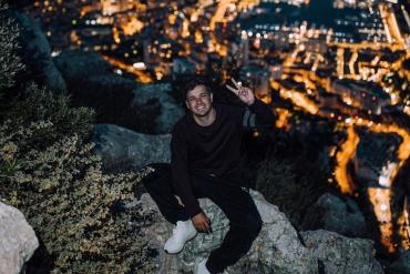 Martin Garrix smiling at night