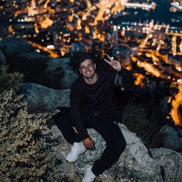 Martin Garrix smiling at night