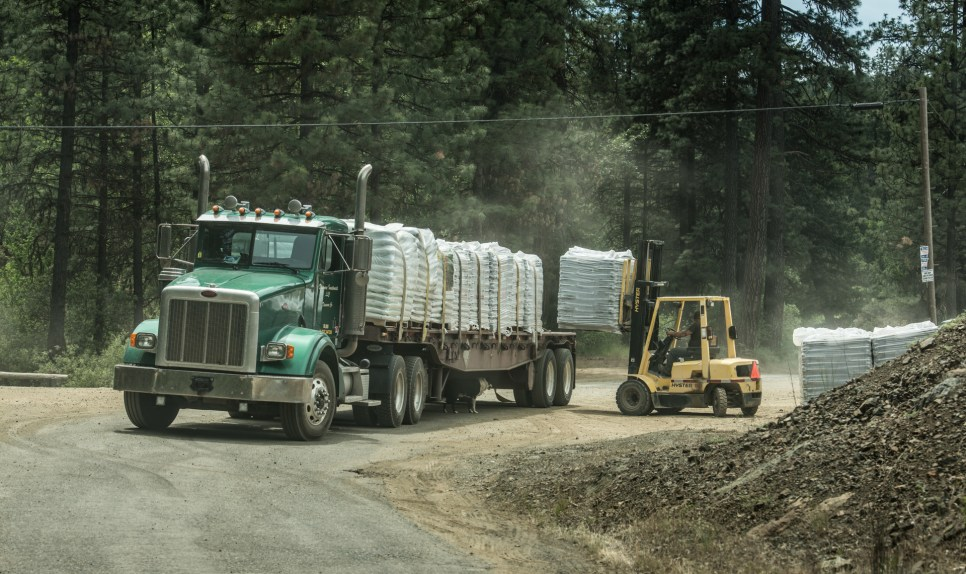 A truck delivering soil in the Trinity Pines subdivision.