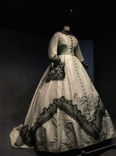 An 1865 silk dress, decorated with black lace