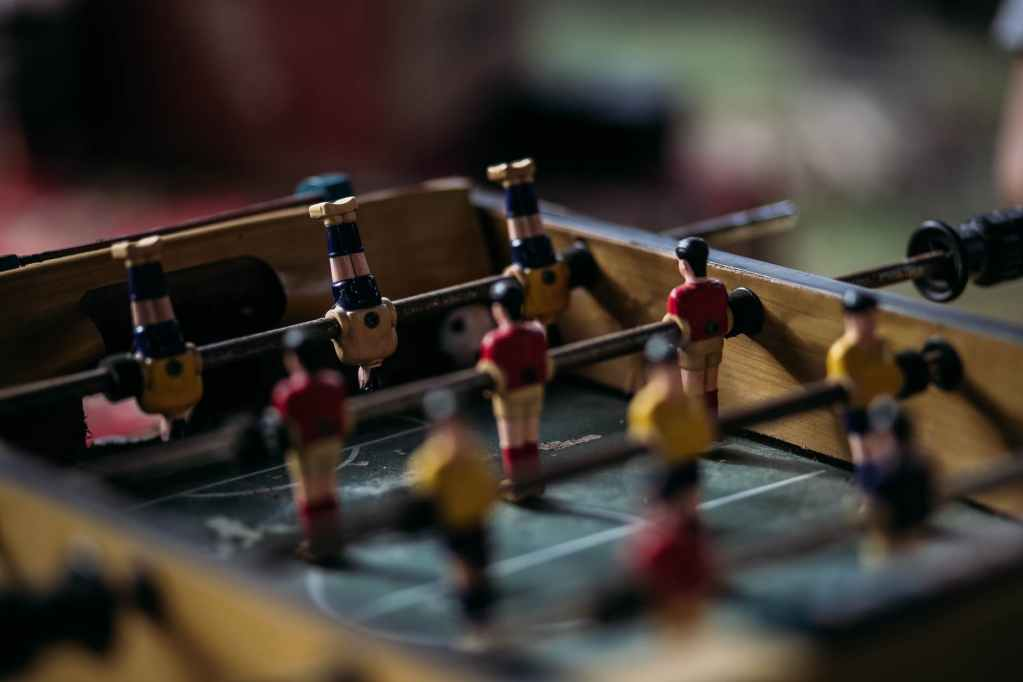 "Photo by Denniz Futalan on <a href=""https://www.pexels.com/photo/close-up-photography-of-table-football-2306897/"" rel=""nofollow"">Pexels.com</a>"