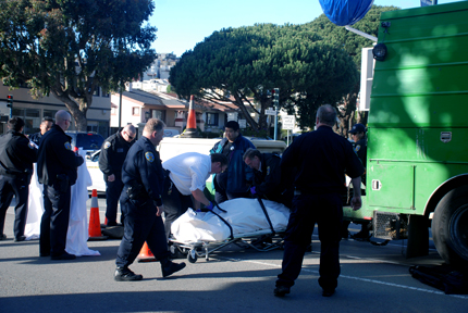 Medical examiners prepare to remove the body of an elderly pedestrian, who was struck and killed by an SFPUC vehicle on Ocean and Miramar avenues on Feb. 9. RAMSEY EL-QARE / THE GUARDSMAN